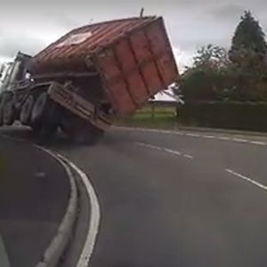 WATCH: Large Wagon Tips Over style=