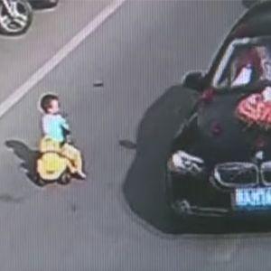 WATCH: Kid Drives Toy Car Through Traffic