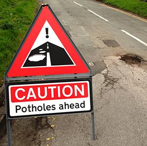 Potholes-Ahead-sign-fleet-news