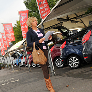 Woman-car-dealership-forecourt-fleet-news