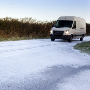 Van on icy road - web