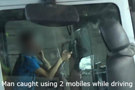 Driver on two mobiles