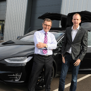 FIAG chairman Geoffrey Bray (left) with Hamish Phillips corporate sales managerTesla Motors