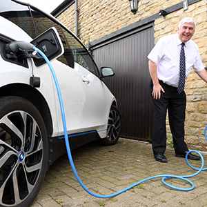 Keith McLean with his BMW i3 and new Electric Nation smart charger