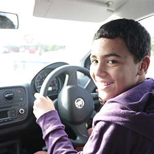 A Young Driver behind the wheel of the car