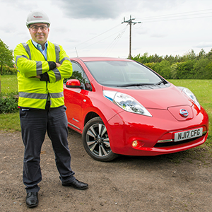 Patrick Erwin with the 100% electric Nissan LEAF