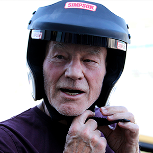 Sir Patrick Stewart revving up to race at the Silverstone Classic