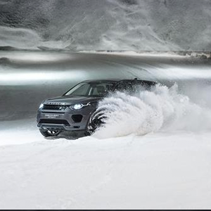 Dog power vs horsepower in the Discovery Sport snow tunnel challe