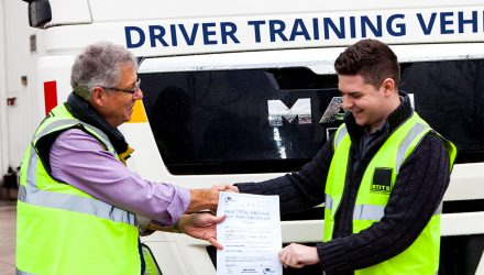 Trainee HGV driver getting his pass certificate