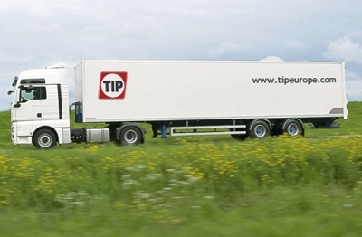Side view of a lorry pulling a TIP trailer